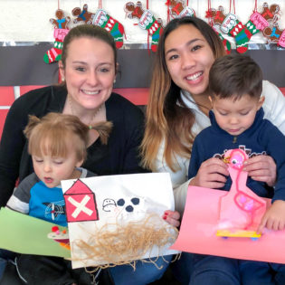 The Cornell Alpha Xi Delta sorority sisters donated Sensory Stories, and spent time reading with the toddlers in one of Racker's Earlchildhood Daycare classrooms