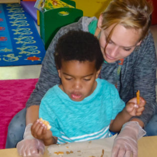 Early Childhood - Certified Behavior Technician works with student