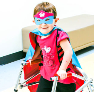 Kailey the Superhero at Racker - Your support of Racker Centers helps children like Kailey learn, grow, and thrive!